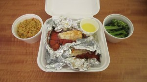 Lobster tails with seasoned rice and steamed broccoli