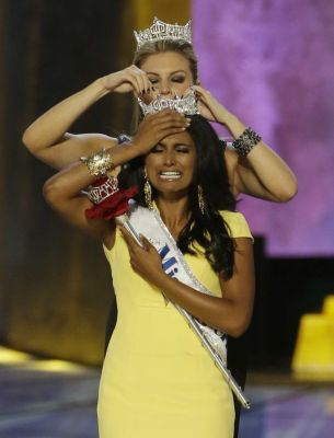 Miss America 2013 Mallory Hogan of Brooklyn crowns fellow New Yorker Nina Davuluri of Syracuse