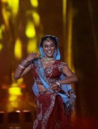 Nina Davuluri honors her Indian heritage during the talent competition Photo Credit: Mel Evans, AP