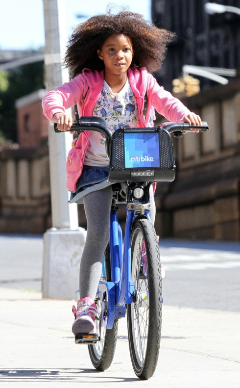 Quvenzhane Wallis rides a Citibikie through Harlem on the set of 'Annie'